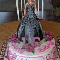 Sweet 16 Cake Barbie's cake dress was copied from a picture that the client sent of her daughter's dress that she would be wearing at her party...
