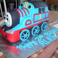 Thomas The Tank Engine Buttercream icing with fondant decorations. Thomas' face is hand made from fondant