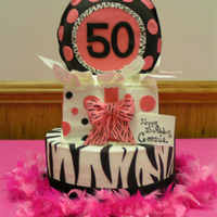 "50Th Birthday buttercream with fondant decorations, balloon is 9"" cake stood on end, covered in fondant"