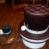 Hats Off This cake was to duplicate the hat pin on the left. The cake is actually black but the picture made it look brown. Stood a foot high