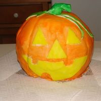 Jack O. Lantern i'm only 19 but i think this cake decorating thing is really cool so i'm gettin in to it. this is my first cake i've ever...
