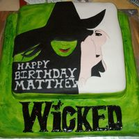 Matt's Wicked Birthday Cake Wicked cake for my son's Wicked themed birthday party. Yellow cake with fondant and royal icing decoration.