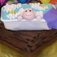 Baby In A Bath Tub Baby shower cake - rolled fondant, water is decorator icing. Top cake is chocolate pound, bottom is vanilla pound