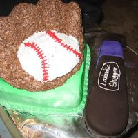 Baseball my friend and I made this cake for a sweet sixteen party. The glove has been molded out of rice krispy treats. We put dowls behind the...