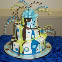 Brown And Blue Whimsy For A 16 Yr Old this was a 6, 10 and 14 inch rounds carved and used SFS. iced in buttercream and fondant accents, 22ga wire with fondant dots and tylose...