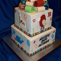 Alphabet Baby Shower Iced in Ivory buttercream with multi colored fondant accents that matche dthe invites and partyware. Bow is made from tylose added to...