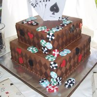 Big Ole Chocolate Grroms Cake 10 and 14 inch squares, fondant poker chips and diamonds, edible image cards on top.