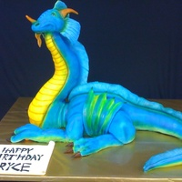 3D Dragon Dragon was 40 inches long, 2 feet tall to tip of head. Head is egg shaped styrofoam, 7 pounds of modeling chocolate in the neck structure,...