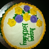 Wilton Second Class (Flowers And Design) Basket weave with royal icing flowers on top.