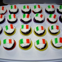 Italian Flag Cupcakes   Made these for my kids hertiage class. Each cupcake is deocrated with a fondant flag each coloured using food colouring