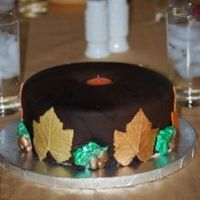 Candle Cake 2 9' butter pecan cakes with cream cheese filling, caramel SMBC, & dark chocolate fondant. 1/2 gum paste 1/2 fondant leaves &...