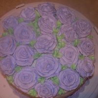 Practice Cake I'm having trouble with buttercream roses. I can't get the centers stiff enough - I even tried freezing them! Also, my roses are...