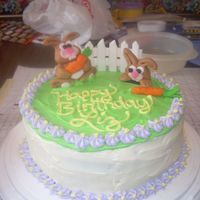 Bunny Carrot Cake This was my first decorated cake. The bunnies and fence were made out of fondant - the rest was cream cheese frosting.