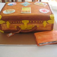 Antique Luggage With Travel Stickers And Book Luggage is covered in fondant ....I made the travel stickers out of gumpate which I then hand painted the images on. The Locations are...