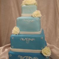 Stacked Blue Squares With Bc Roses covered in fondant with piped accent and bc rosesI had a very last min cake order and thought this cake would be simple enogh to be able to...