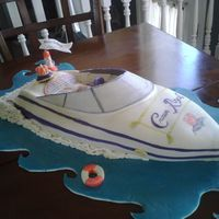 It's Crown Time Boat Crown Royal themed sports boat carved then covered in fondant. Hand Painted embellishments with food coloring.