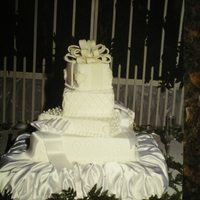 Wonders In White Extravigate all white off set square wedding cake!
