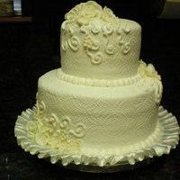Small But Sweet Simple floral design and swirls to accent this round wedding cake.