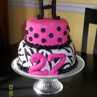Zebra Dots Fondant Cake 2 tier stacked zebra/polka dot fondant covered cake with fondant initial/number