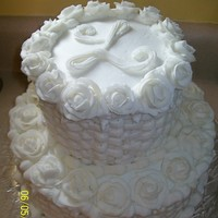 White Rose And Basket Weave 2 Tier Wedding Cake 2 tier stacked cake with butercream icing/royal icing roses and initial
