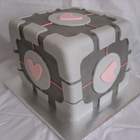 "Companion Cube  A companion cube cake made for the father of an old friend! This took a LONG time. However, the next day she told me the cake tasted ""..."