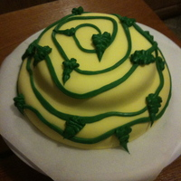 Lemon With Fondant And A Green Vine This is my first attempt ever at a fondant cake. It's a lemon cake, with lemon icing under the fondant. I was sort of going for a Tim...
