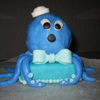 Octopus, Babies 1St Birthday. Little Mini Octopus cake for the 1yr old i Nanny for. Madeira Cake, with 'Cake Balled' head covered with Fondant.