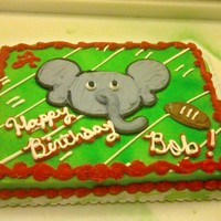 Crimson Tide Themed Cake This is a very popular design at the bakery as the big sport around here is college football and my town is largely a Crimson Tide town.
