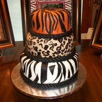 Animal Print Wedding Shower Cake This is a three tier cake all made with buttercream and fondant. The first layer (zebra) was white cake, the 2nd (leopard) was german...