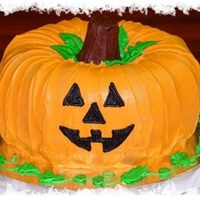 Happy Halloween My mother and i had fun with this cake. We used to bunt cakes to make the pumpkin. Then frosted him with orange icicle dyed a darker orange...