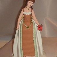 Victorian Inspired Lady. Made on a styrofoam-cone. Skirts made of sugarpaste, hair is royal icing.