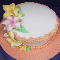 Final Cake For Wilton Fondant And Gumpaste Class Marble cake covered in fondant with gumpaste plumeria flowers. My first ever fondant cake.