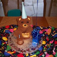 Birthday Bear 3D Bear Pan done for little boy's birthday. Little cake is a cupcake torted to add height. Attached a balloon to the gift bag, but...
