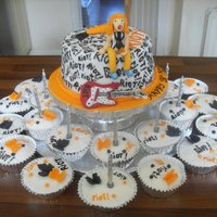 Paramore Cake. This cake and cupcakes were based on the band Paramore and one of their albums called Riot.