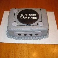 Nintendo Game Cube This was a last minute order for a 13 year old boy who loves video games and has all the Nintendo games! The cake is Chocolate fudge with...