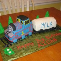 Thomas The Tank Engine This is my first carved 3D cake! I was so nervous. Cake is devils food. All icing is cream cheese except trees are made with royal icing!!...