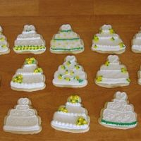 Wedding Cake Cookies I had been dying to try these. I used No Fail sugar cookies and rolled buttercream with royal icing accents! They were a huge hit and were...