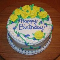 Yellow Rose Birthday This is a lemon cake with cream cheese icing. Customer wanted yellow roses!!