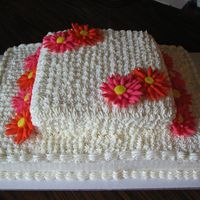 Img_4602.jpg This is the first time I had tried Gerbera Daisies and my first Bridal shower cake