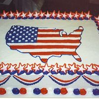 Patriotic Cake Buttercream icing with 50 royal icing stars around the border. The map of the US done in the style of the flag. Winner of the 2004 4th of...