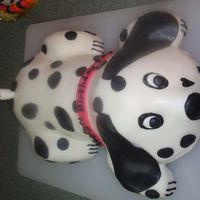 "Paige's ""pongo"" Cake The rear is 1 mix wonder pan, 4 mini loafs pans for legs, carved, (1) 8 inch round cut in half for body and 1 1/2 mix wonder pan for head...."