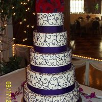 Italian Nut Wedding Cake With Ganache Filling/ Red Hat Society This cake was a little stressful. My friend and I did this together. We also did a grooms cake. My friend used the Viva paper towel trick...