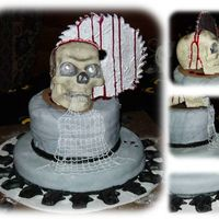 """saw"" Cake The skull and saw blade are three seperate pieces of solid white chocolate that were glued together with more white chocolate and shaded..."