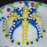 First Fondant Cake This is my first fondant cake or any kind of decorated cake for that matter. Comments are greatly appreciated. Thanks!