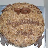 70Th Birthday Cake This is a german chocolate cake with chocolate decorations and numbers for a friend of ours from Sunday School class that was turning 70.
