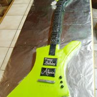 Life Sized Guitar Cake This is a replica of my best friends, son's guitar. His is metallic blue in color. lol, he was a great technical consultant for us on...