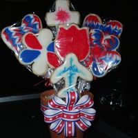 My First Cookie Bouquet! NFSC and Toba Garrett's Glace Icing flavored with Loran's Bavarian Cream. The icing is absolutely delicious! I made this for my...
