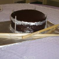 Very Chocolate Grooms Drum Cake This was almost a complete disaster. The fondant strips were too heavy for the chocolate ganache covering the cake. Last minute we decided...