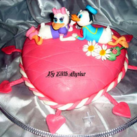 Daisy And Donald Duck Anniversary Cake  This was for a couple's anniversary. She loves Daisy, therefore I modeled Donald to go along since it's the couples anniversary...