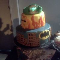 Super Hero Groom's Cake The groom loves Batman, Ironman, and the Green Lantern. LED lights were inserted into the fondant Green Lantern ring on top and a poured...